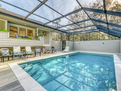 Photo for Expansive home just steps form the beach w/ screened-in pool & deck!