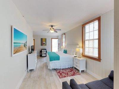Photo for NEW LISTING! Spacious studio with a shared courtyard and shared pool!