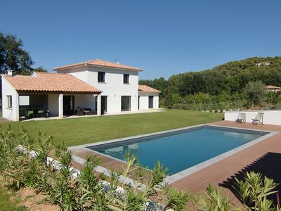 Photo for Quiet contemporary house with secure heated pool and large garden