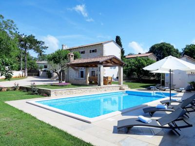 Photo for 3 bedroom Villa, sleeps 7 in Tomišići with Pool, Air Con and WiFi