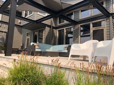Comfy and plentiful seating options to enjoy your outside time w/sails for shade