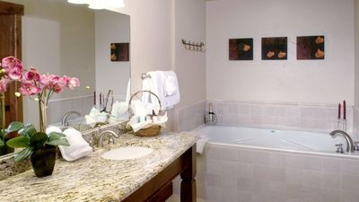 Master bath has two sinks and a soaking jetted tub.  there is a guest bath also