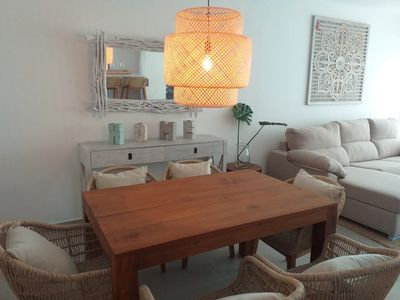 Photo for Luxurious condo steps from the beach. B2