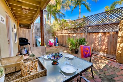 Private patio with outdoor seating for 4 and gas BBQ.