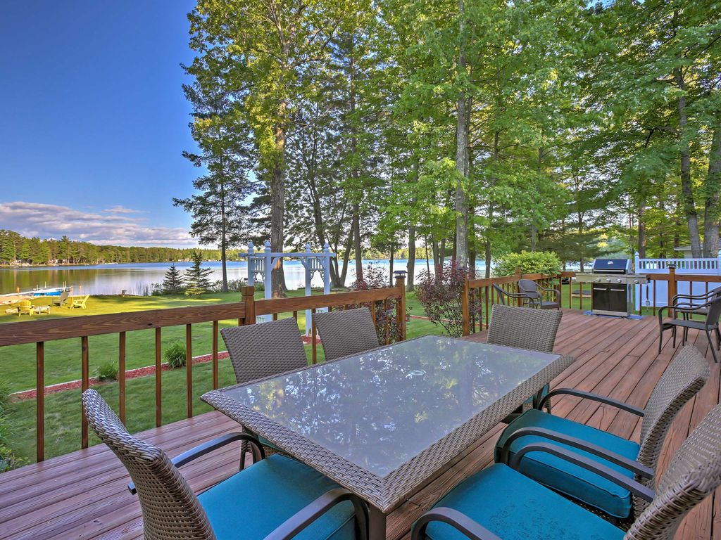 Lakefront interlochen home w deck fire pit dock