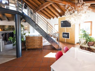 Photo for Beautiful large bright apartment on Lake Garda with a large roof terrace