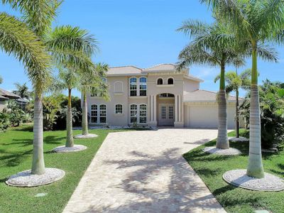 Photo for Fabulous Gulf access water views on a  wide canal minutes to Cape Harbour 6 Bedrooms 6 Baths slee...