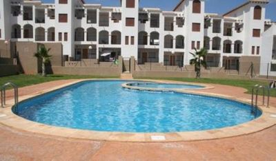 Photo for 2 bed air conditioned ground floor apartment with pool. La CinuelicaTorrevieja
