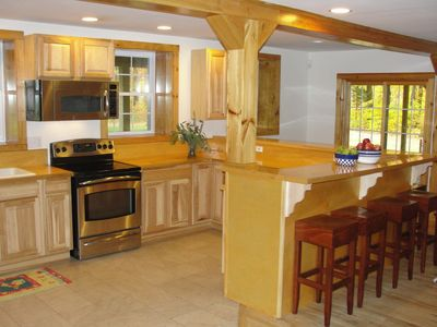 kitchen with large counter and stools to easily feed the family