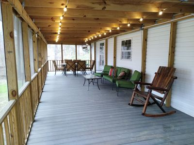 Screened in back porch with new lighting and 2 fans.