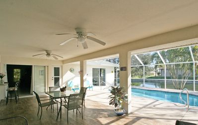 Photo for All day sun. Heated pool. Canal views. Modern decor. Shops & restaurants nearby.