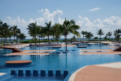 A partial view of the pool with the ocean in the background.