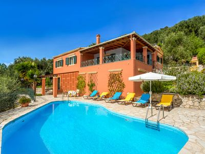 Photo for Ideally located villa close to bay, resort and town with amazing views and a pool.