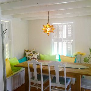 Beautiful dining area and also a second dining area and window seat in kitchen