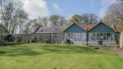 Photo for 2 self-catering cottages booked as one with secure garden area.