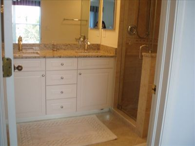 Masterbath with spa-like amenities completely renovated with granite counters.
