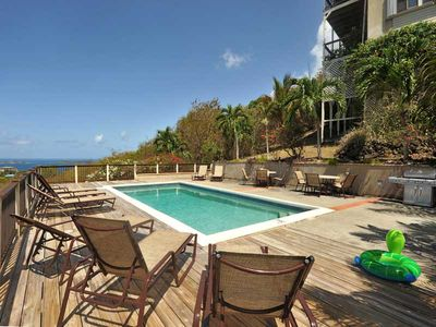 Huge pool, gorgeous views with a large BBQ grill steps away from the condo.