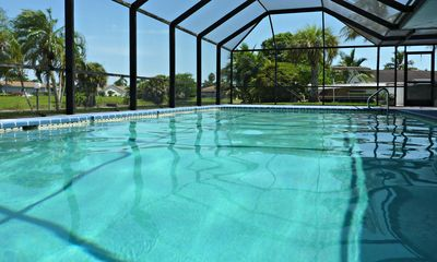 Photo for Dream house in TOP location right on the canal with heated pool, boat deck u. V. M.