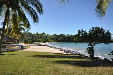 View from the north side of property looking south to our beach, and high tide