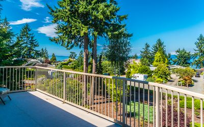 Photo for Steps to Beach!  Incredible ocean view property in Qualicum Beach