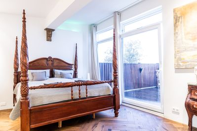Your Master Suite opens onto the balcony to enjoy the Hot Tub and views