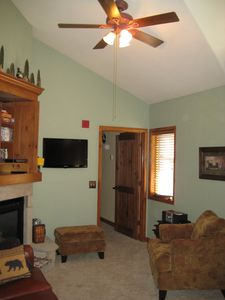 Living area...ceiling fan for your comfort. 3 window in the living are.