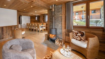 Photo for Prestigious chalet for 12 people, sauna and jacuzzi, near the center and slopes