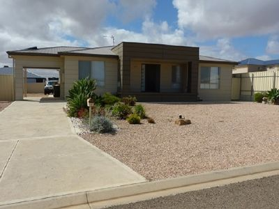 Photo for PEBBLES PARADISE is a 4 bed 2 bath modern home  a couple minutes from the beach.