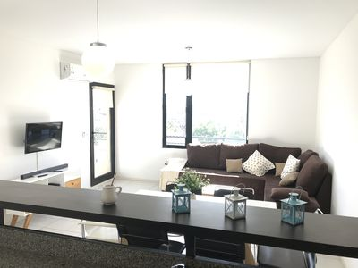 Relax in the luminous and spacious living room
