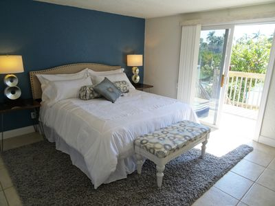 Master bedroom, fresh and bright with waterfront balcony access.