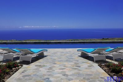 Gaze at unobstructed ocean views while swimming  in the 60-foot, heated pool