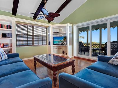 Living room with vaulted ceilings and Gulf of Mexico views, with SGD to liana.