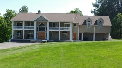 Photo for Beautiful 8 Bedroom-40 acres-Hunter-Ski/Board,Relax,EnjoyNature,Cook/BBQ,NO PROM