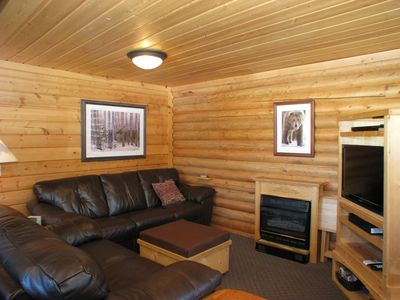 The living room where you can relax with a satellite TV and gas fireplace