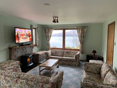Living / Dining room looking over the sea to the Isle of Skye