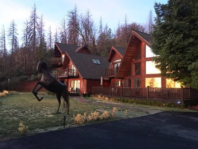 Photo for Stunning lodge style home on 8 private acres. Backs up to the national forest!