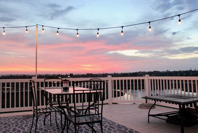 Enjoy the stunning views of the Pacific Ocean from the back deck and fire pit.