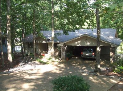 Front view of the property with 2 car carport and ample parking for 2 more cars.