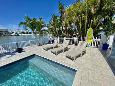 Photo for Waterfront 4 Bed 4 bath home with heated pool.  6 pass  golf cart included !!!