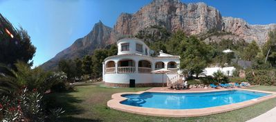 Photo for White pool villa with stunning panoramic views in a large garden