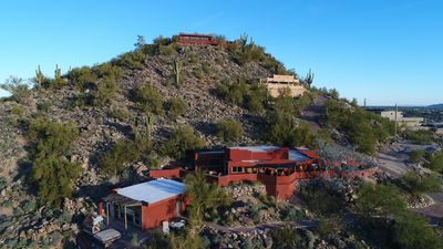 Sunset Mountain Casita Ranchero is the lower rust color house