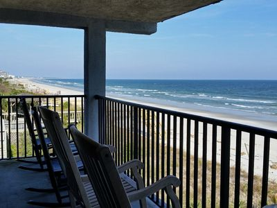 Photo for Direct oceanfront in gated peninsula locale, 2 pools, creek dock, 7 mile beach