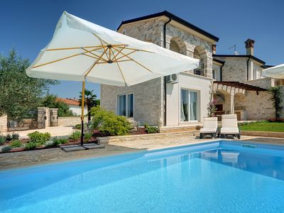 Photo for This 3-bedroom villa for up to 6 guests is located in Rovinj and has a private swimming pool and air