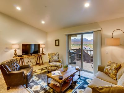 Photo for 5 miles from Moab Rim w/ balcony, shared pool & hot tub  - free WiFi & more!