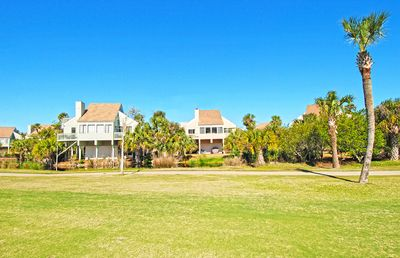 View of 947 Sealoft from the golf course in the back yard:  11th fairway of the Ocean Winds Course.