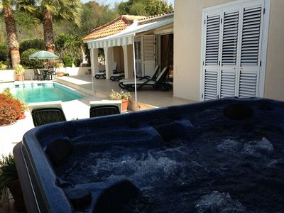 hot tub across the pool and garden
