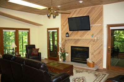 Great room with 51 inch flatscreen TV and gas fireplace