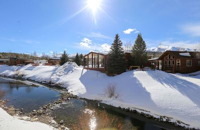 Photo for Beautiful Newly Built Cabin on the river, mountain views, double decks, minutes to skiing!