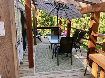 Deck with outdoor dining area, propane fire bowl and small BBQ