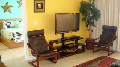 Get comfy on leather chairs and enjoy your 46' LCD TV and DVD player